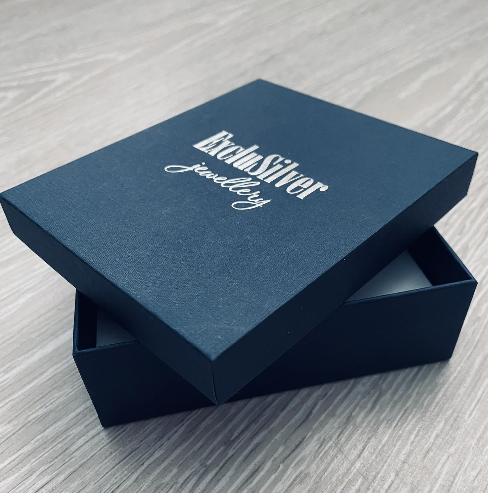 Коробки из переплетенного картона